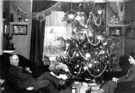 [L.D. Taylor and Katherine Federici sitting in Granville Mansion living room at Christmas]
