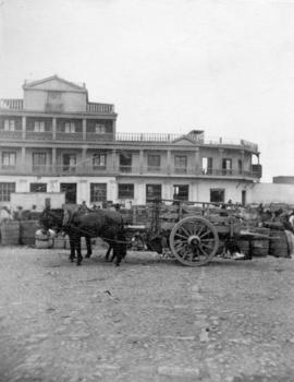 [Donkey and cart in front of building at] Coquimbo