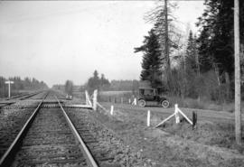 [View of car near railroad tracks]