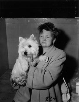 Woman with entry [West Highland Terrier?] in 1955 P.N.E. Dog Show