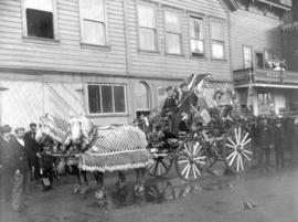 [Chemical fire engine and horses decorated for a parade outside Fire Hall No. 1 on Water Street]