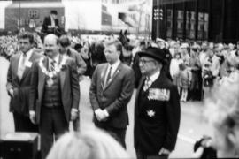 Michael Francis, Mike Harcourt and two unidentified men in front of press
