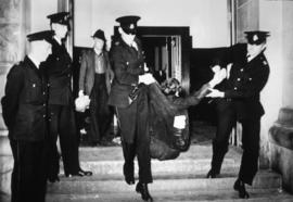 Post Office sit-in [police removing man from building]