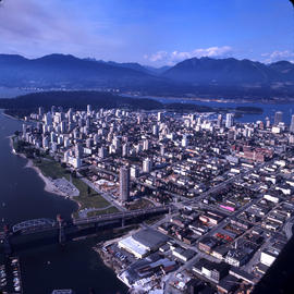 Aerial view of Vancouver : looking north west showing Burrard Bridge, Sunset Beach and north east...