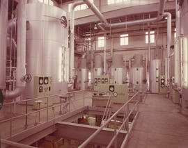 Completed new pan house: interior view of large tanks and control panels