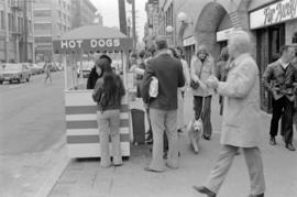 Water Street sidewalk, hot dog stand