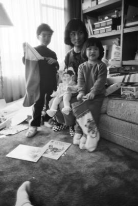 Woman, boy, and girl with doll