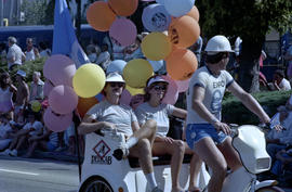 Group wearing Expo '86 merchandise in pedi cab