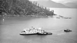 S.S. Smokwa [pushed along route by tugboat]