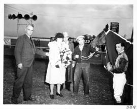 Prize presentation after horse race