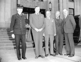 Honourable Ian McKenzie [and others at City Hall]