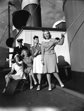 "C.N.R. publicity [shot showing] models [onboard S.S. ""Prince George""]"