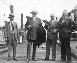 [Group portrait of L.D. Taylor, Sir Henry Thornton, [Frank D.?] Russell,  Port Superintendent K.[...