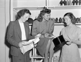[Women looking at items at the Junior League Thrift Shop]