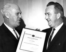 1966 presentation Bus Evans : [P.N.E. President H.J.C. Terry presenting the International Associa...