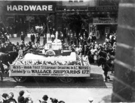 [Wallace Shipyards float in the 600 Block of Granville Street during a Victoria Day parade]