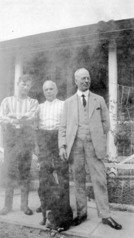 [L.D. Taylor with two unidentified men and dog]