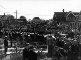 [The crowds watches as  King George VI and Queen Elizabeth leave by car]