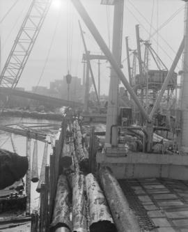 Logs for Canadian pavilion at 1969 world fair, loading B.C. fir logs on Japanese freighter Ho-O-Maru