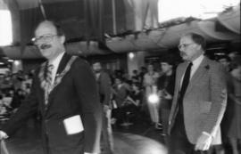 Mike Harcourt and unidentified man walking through Vancouver Museum