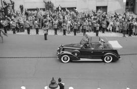 [King George VI and Queen Elizabeth in car on Granville Street near Hastings Street]