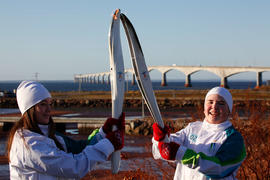 Day 25 Torchbearer 23 Yves Boudreau passing the flame to the Torchbearer 24 in front of the Confe...