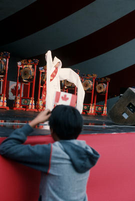 Audience member watching the Kang Sun Young's Dancers performance during the Centennial Commissio...