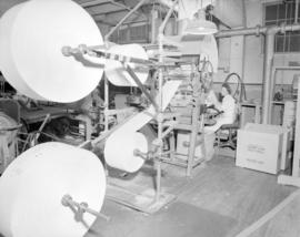 [Woman operating paper roll machine for] Pacific Mills