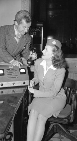 [Operator and stewardess with a Trans-Canada Airlines short wave phone]