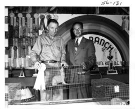 Men with award-winning mink from 1956 P.N.E. Fur and Feathers show
