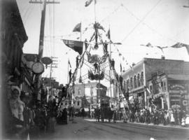 [Royal progress passes beneath Fireman's Arch on Cordova Street west from Cambie Street]