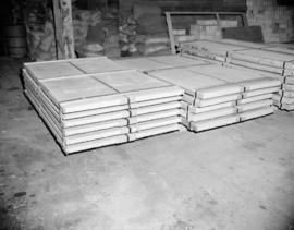 [Large, flat crates stored in the Evans, Coleman, and Evans Ltd., warehouse]