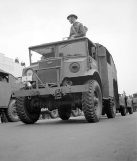 [Soldier in an armoured vehicle in a military parade]