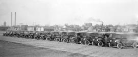 Shipment of new trucks [parked on the south side of Prior Street at Gore Avenue]