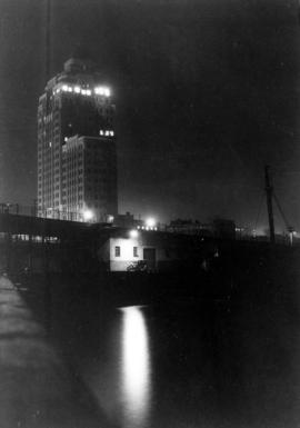 [Night photograph of the] Marine Building [taken from the pier]