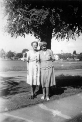Doris Armstrong (right) and Florrie Wilson in [front of Heather] park by 3500 Willow Street[, Van...