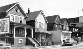 [Residences and business on the west side of the 1100 block Hornby Street looking north]