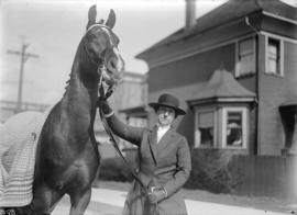 Mrs. A.D. McRae [with horse]