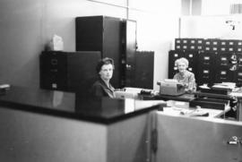[Mrs. Jean G. Gibbs and Miss Edna Stott in the Archives' office]