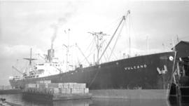 S.S. Vulcano [at dock, with cargo-filled barges alongside]