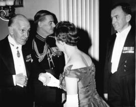 [His Excellency Vincent Massey greets an unidentified woman]