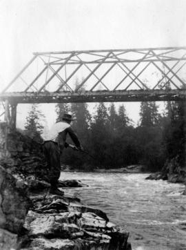 [Man fishing in river]