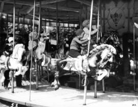 Children riding merry-go-round