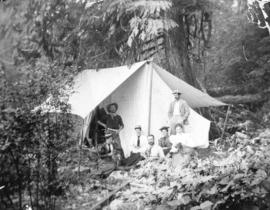 [H.C. Akroyd and others in a tent in a logging camp]