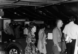 Crowd by Volkswagen Beetle on display in Pacific Coliseum at 1970 P.N.E. Import Auto Show