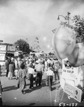 Crowd, concessions, and rides in P.N.E. Gayway