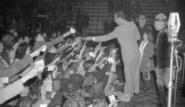 [Dennis Day greeting fans at the Forum]