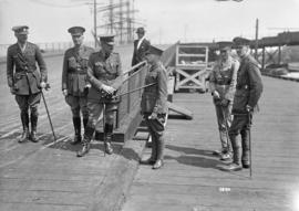 Military [officers standing informally at docks]