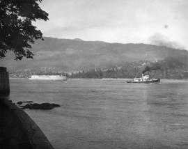 [Bulk Carrier No. 3 (Former U.S. Navy Landing ship) being towed into the harbour]