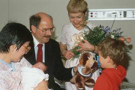 Mayor Harcourt, his son and [Leora Apsouris] visiting with the Vancouver Centennial baby [Cheryl ...